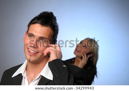 Young attractive colleagues with phone - stock photo