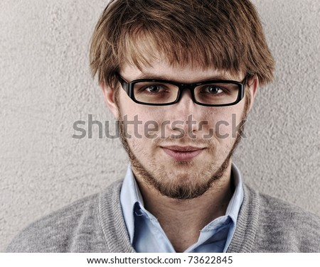 Young attractive confident blond man with glasses