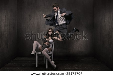 Young attractive couple and british cat in a dark room - stock photo