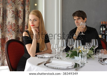 young attractive couple at the restaurant - stock photo