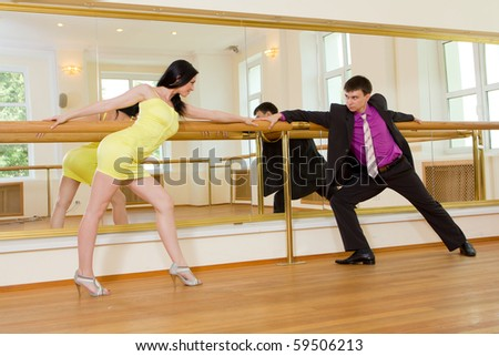 Young attractive couple dancing in the ballroom - stock photo