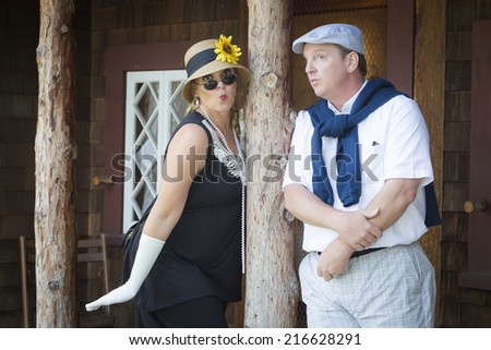 Young Attractive Couple Dressed in Outfits from the Twenties Era. - stock photo