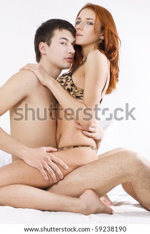 Young attractive couple embracing in bedroom