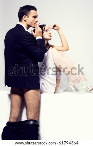 Young attractive couple. Handsome man and sexy woman after sex - stock photo