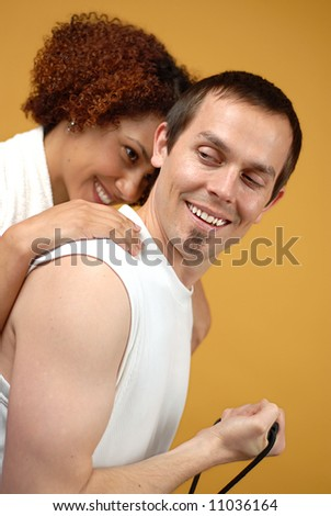 Young attractive couple having fun while working out at the gym - stock photo