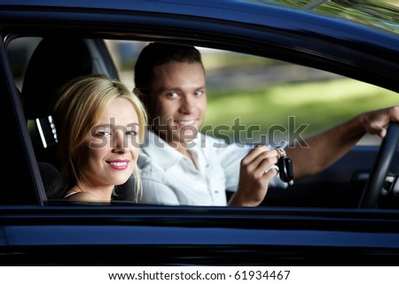 Young attractive couple in the car - stock photo