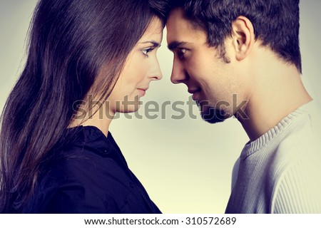Young attractive couple, isolated on white background - stock photo