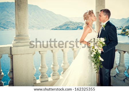 Young attractive couple married outdoors - stock photo