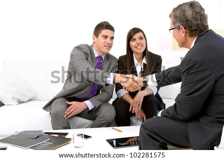Young attractive couple meeting with financial planner. - stock photo