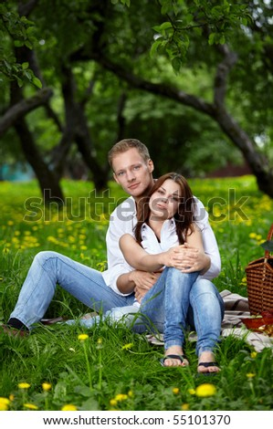 Young attractive couple on rest in park - stock photo