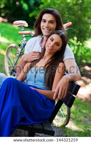 young attractive couple on the park bench