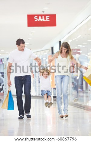 Young attractive couple with a child in the store - stock photo
