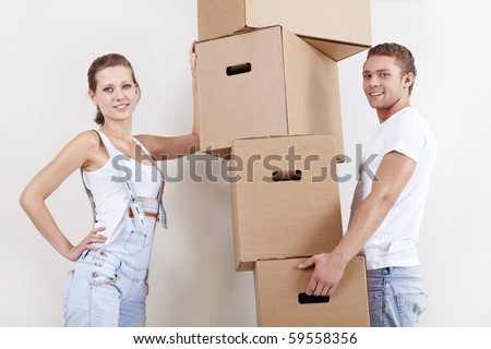 Young attractive couple with cardboard boxes