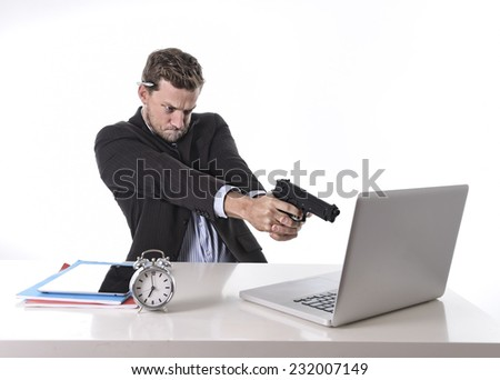 young attractive European businessman working in stress at office desk computer pointing gun to laptop in stress at work and overtime concept isolated on white - stock photo