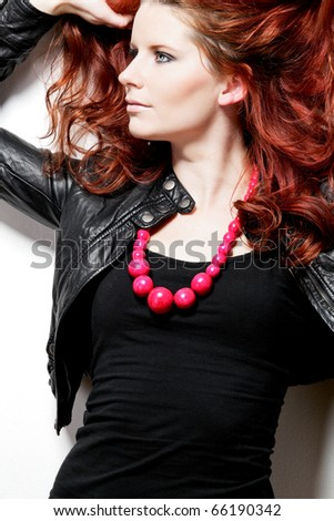 Young attractive fashion model with red hair. - stock photo