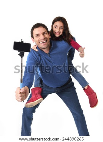 young attractive father carrying cute young daughter on his back having fun smiling happy taking selfie photo with mobile phone together isolated on white background - stock photo