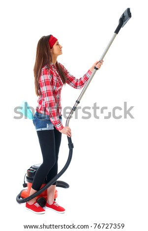 young attractive female cleaner in red shirt use vacuum cleaner, isolated on white - stock photo