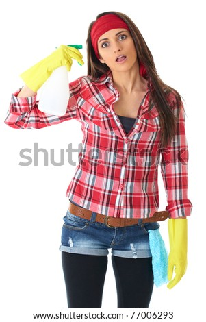 young attractive female cleaner in yellow gloves and red shirt, try to shoot herself with spray bottle, isolated on white - stock photo