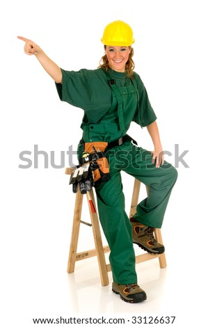 Young attractive female construction worker with green overall and shirt. Studio shot, white background. - stock photo