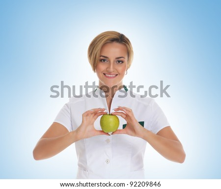 Young attractive female doctor isolated over blue - stock photo