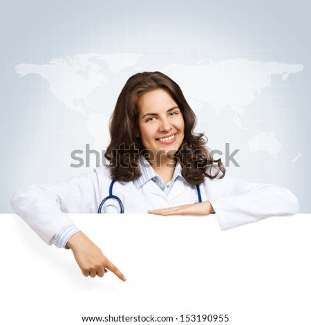 Young attractive female doctor put her hands on the blank banner, points at a place for text - stock photo