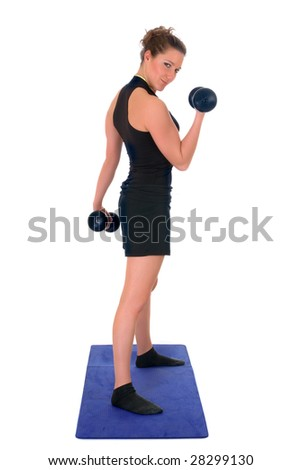 Young attractive female  doing fitness exercises in the gym. Studio shot