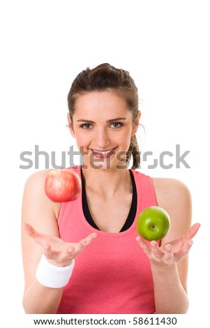 young attractive female in fitness top, holds green and red apple, studio shoot isolated on white - stock photo
