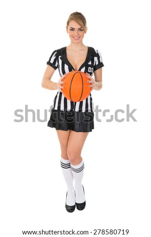 Young Attractive Female Referee Holding Basketball Over White Background - stock photo