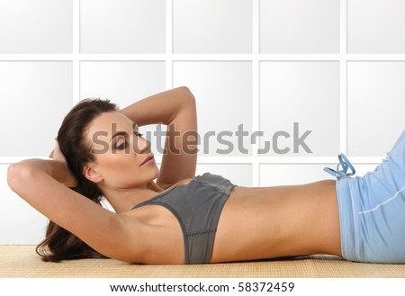 Young attractive female sportsman isolated on white - stock photo