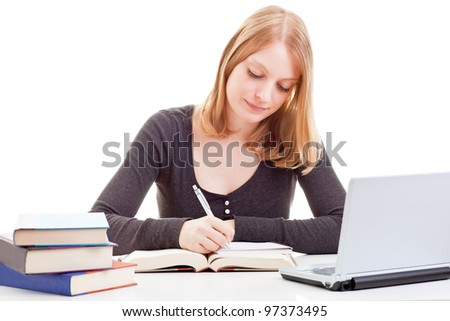Young attractive female student taking notes from open book isolated on white background