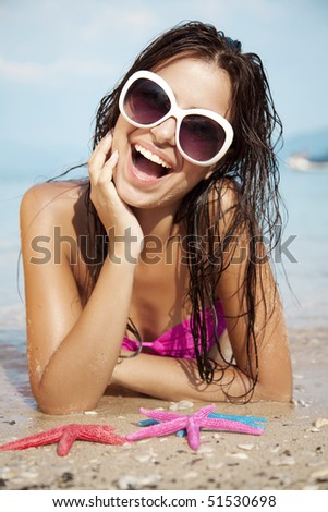 young attractive female sunbathing and having fun - stock photo