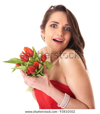 Young attractive female surprised with red tulips, studio shoot isolated on white - stock photo