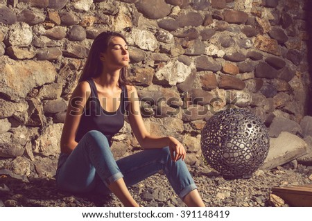 Young attractive female with long hair relaxing - stock photo