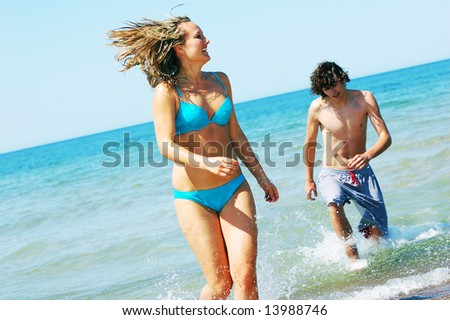 Young attractive friends having fun the summer beach
