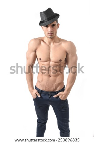 young attractive gay and homosexual man with fashion hat and strong naked torso showing ripped muscle body and six pack abdomen standing alone isolated on white - stock photo