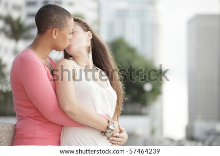 Young attractive gay women kissing - stock photo