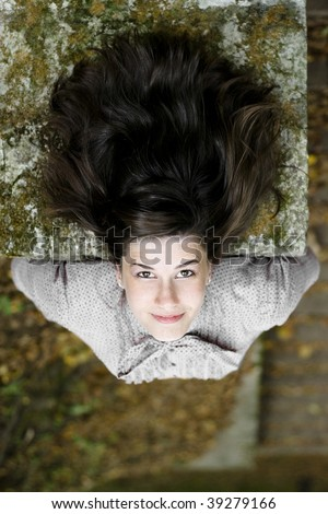 Young attractive girl and a concrete wall - stock photo