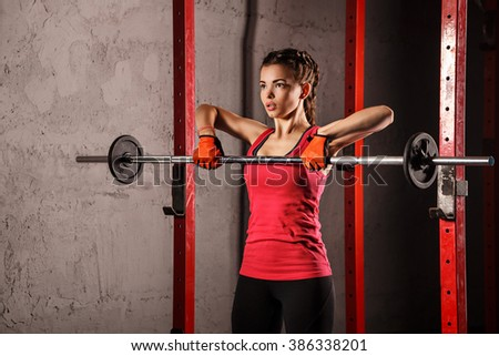 Young attractive girl athlete doing exercises with the weight. Sport Club. Fitness club. Healthy lifestyle concept. - stock photo