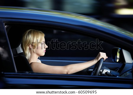 Young attractive girl behind the wheel - stock photo