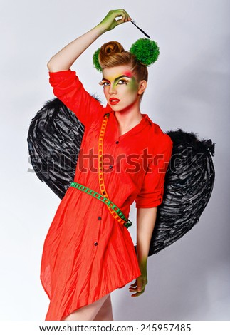 Young attractive girl dressed as Cupid with an unusual make-up on Valentine's Day. - stock photo