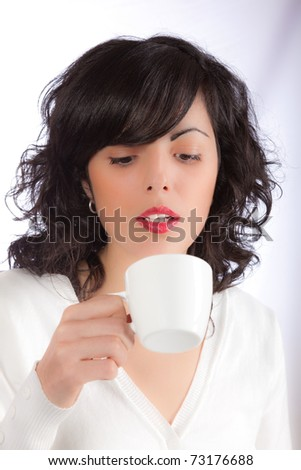 Young attractive girl holding a white cup - stock photo