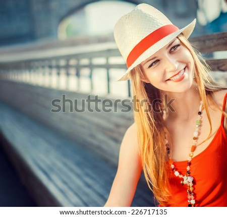 Young attractive girl in a hat - stock photo