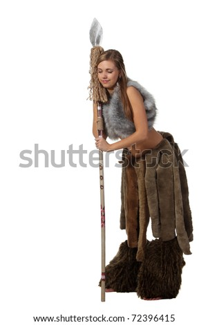 Young attractive girl in costume of savage woman sleep with a spear - stock photo