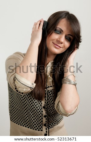 Young attractive girl listening to music with eyes closed - stock photo