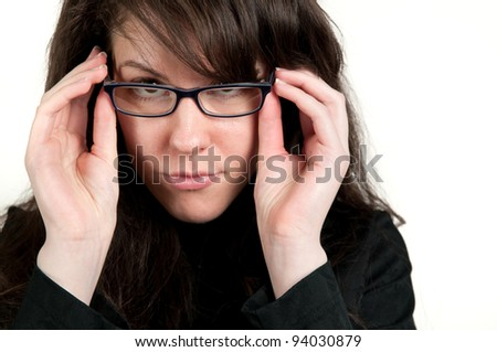 Young attractive girl looking through eyeglasses - stock photo