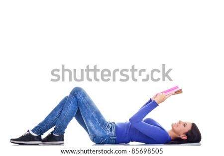 young attractive girl lying and  reading book - stock photo
