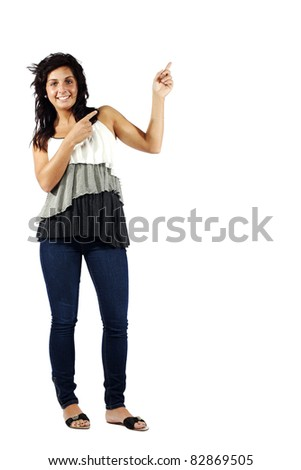 Young attractive girl pointing to her left against isolated background