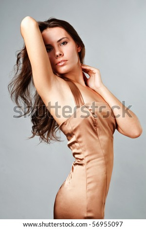 Young attractive girl poses during a photo session