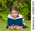 Young attractive girl reading book - stock photo