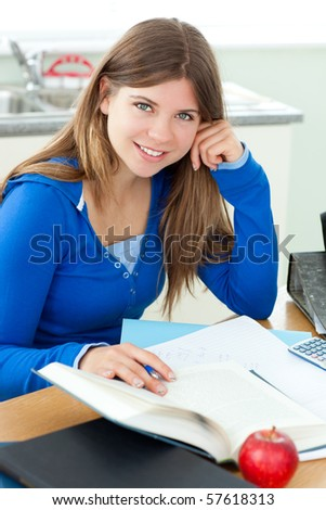 Young attractive girl studying at home